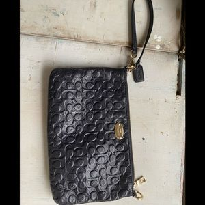 Coach embossed leather signature navy wristlet
